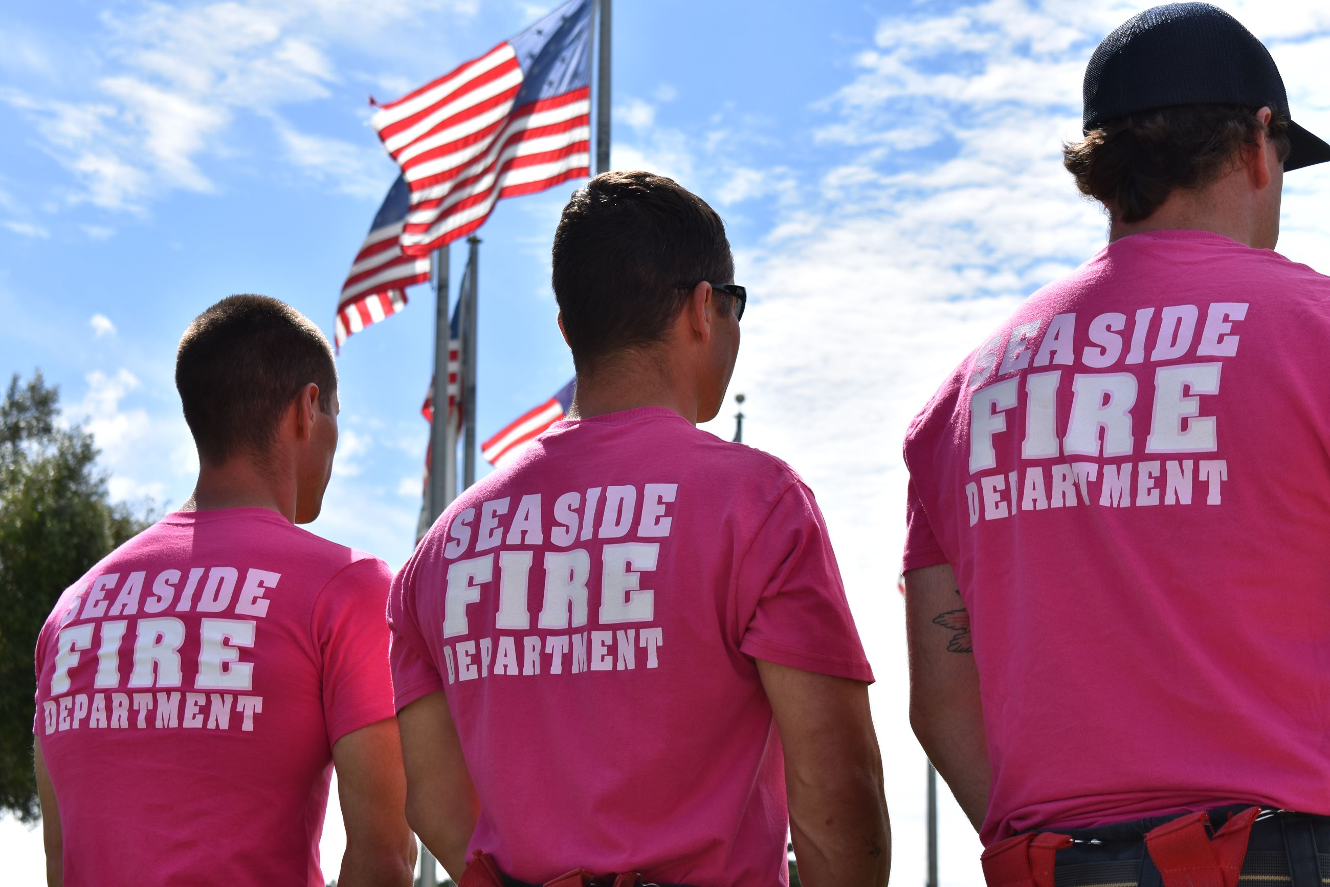 Fire Department Staff wearing pink shirts