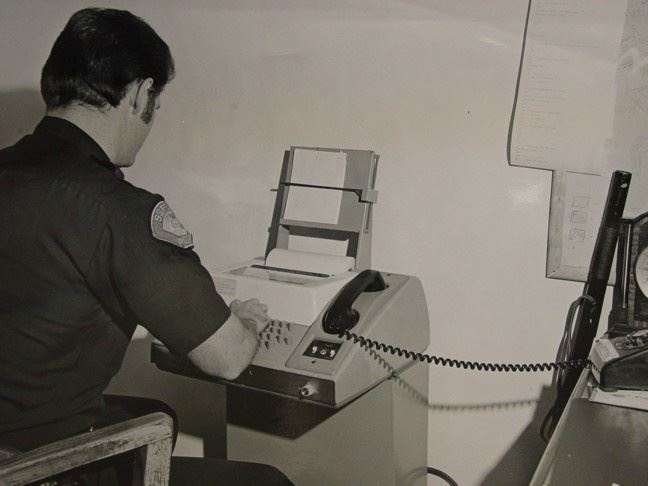 Seaside officer on dial-up CLETS terminal in 1965