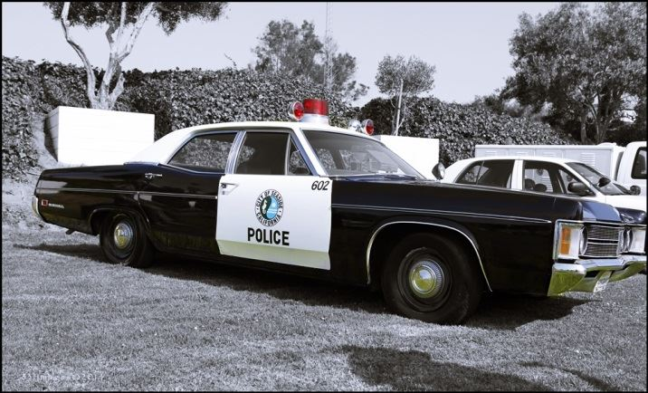 Old Model Police Vehicle parked on City Hall lawn