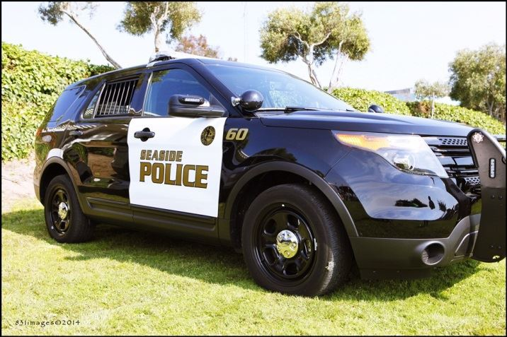 Front view of Seaside Police SUV parked on City Hall lawn