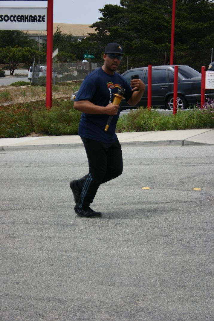 Officer Running With the Torch