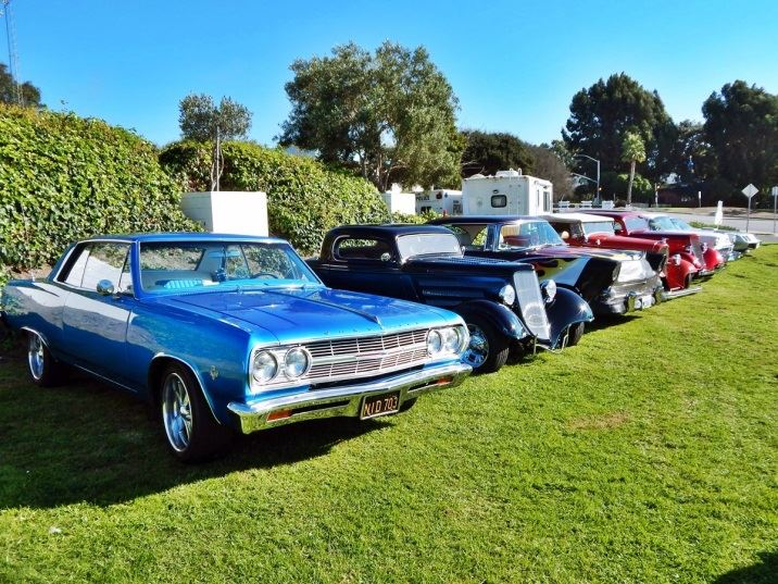 Five classic cars parked on City Hall lawn