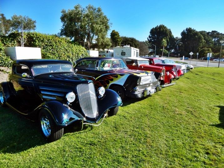 Row of classic cars parked on City Hall lawn