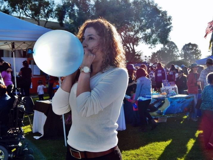 Woman Blowing Up a Balloon