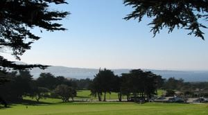Golfing greens with trees overlooking Monterey Bay
