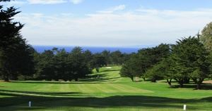 Golfing greens and trees overlooking ocean