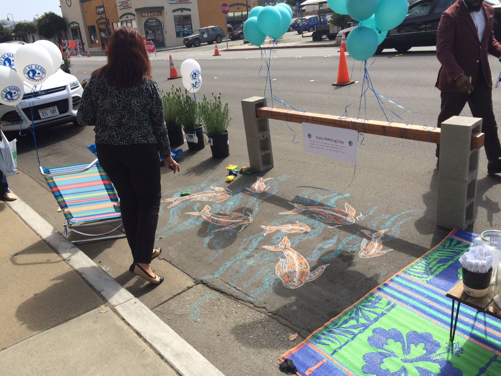 Chalk fish at parking spot at Park(ing) day