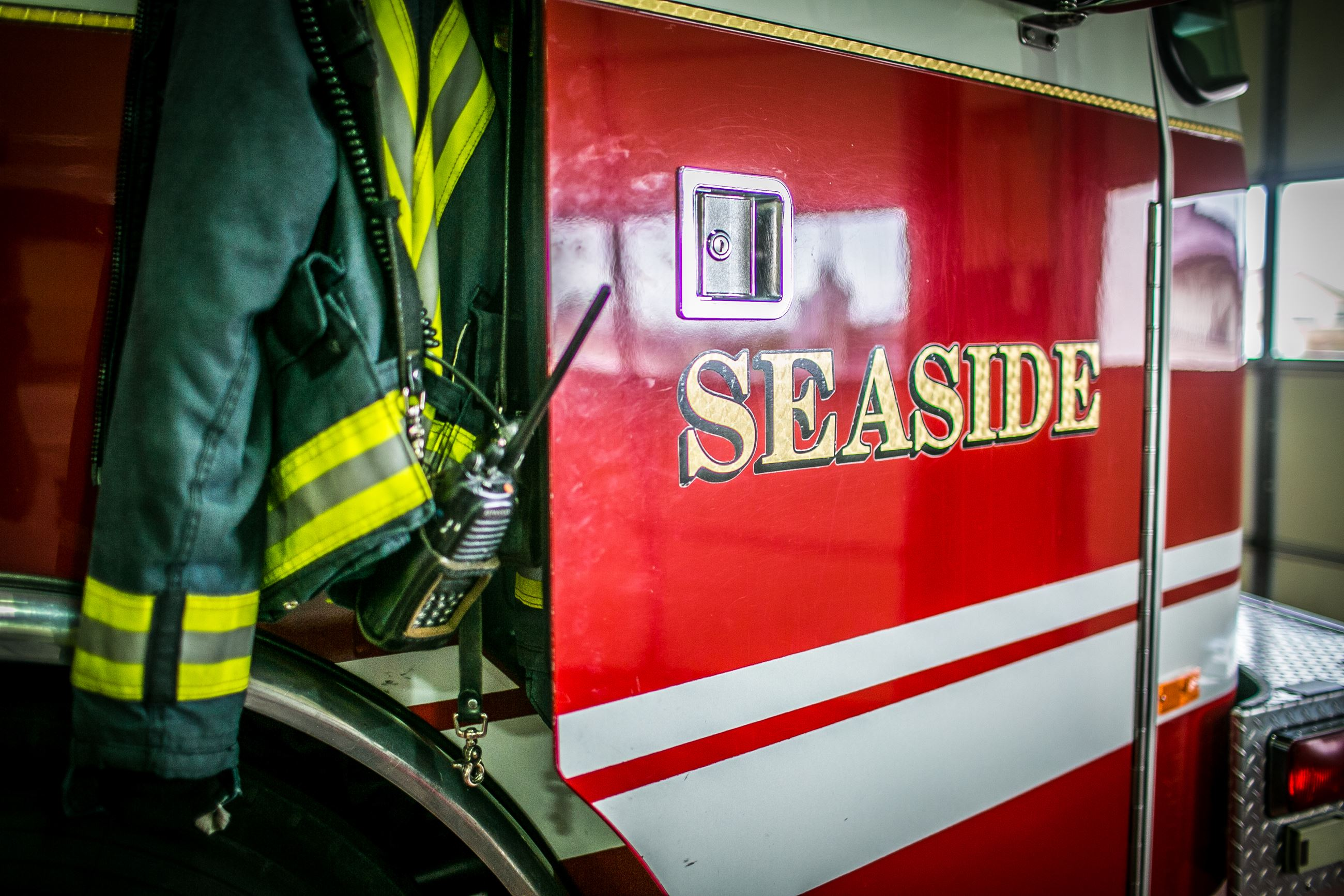 Seaside Fire Department engine door and hanging turnout jacket and radio
