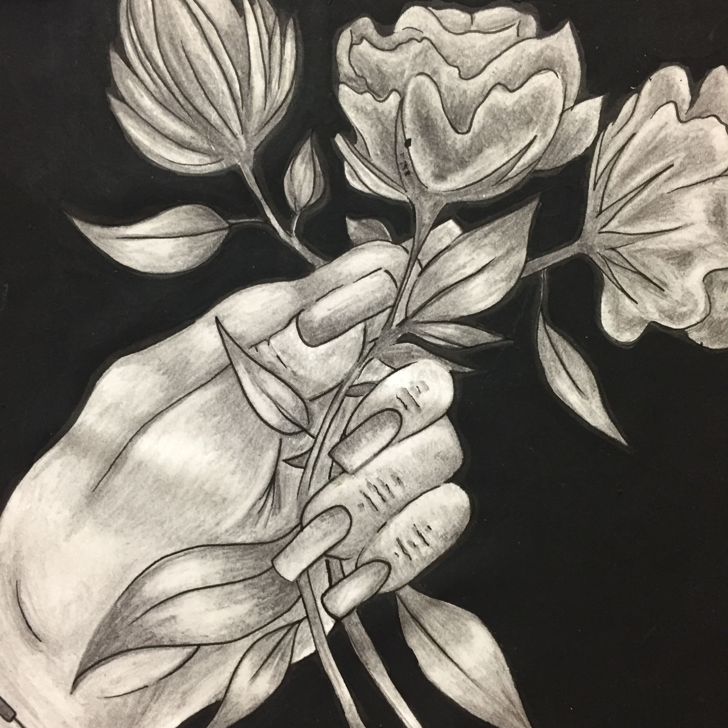 Black and white painting of woman's hand holding flowers