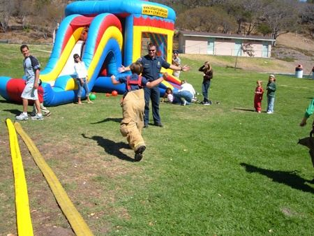 Kid Running in Firefighter Overalls