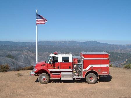 Fire Truck in Front of the American Flag On Top of