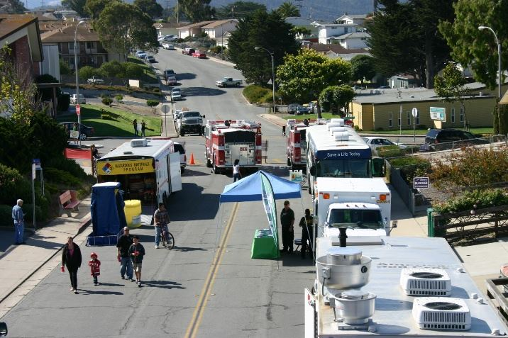 Trailers and vehicles parked along a closed street during the Open House event