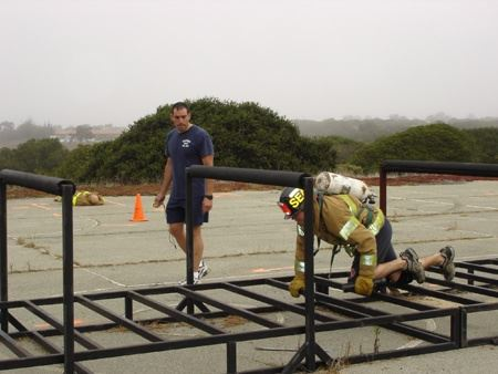 Firefighter on training structure during the Agility Course
