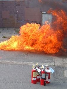 Fire Extinguishers in front of flames