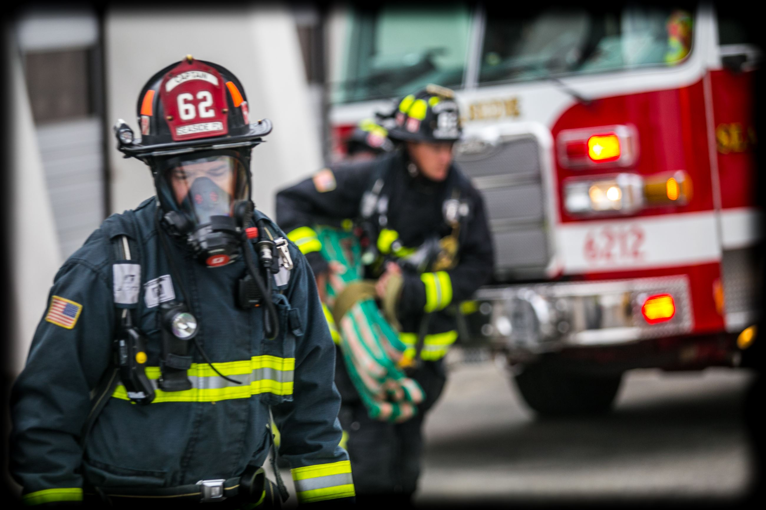 Two firefighters in gear