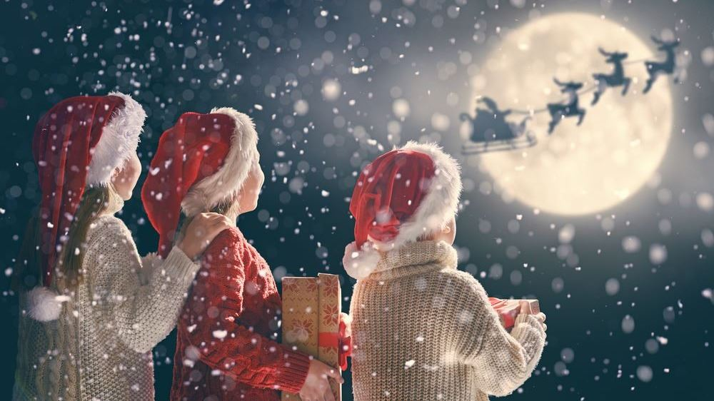 Children watching Santa and Reindeer fly
