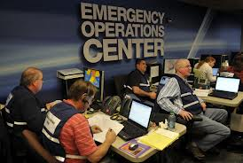 Staff members working inside an Emergency Operations Center